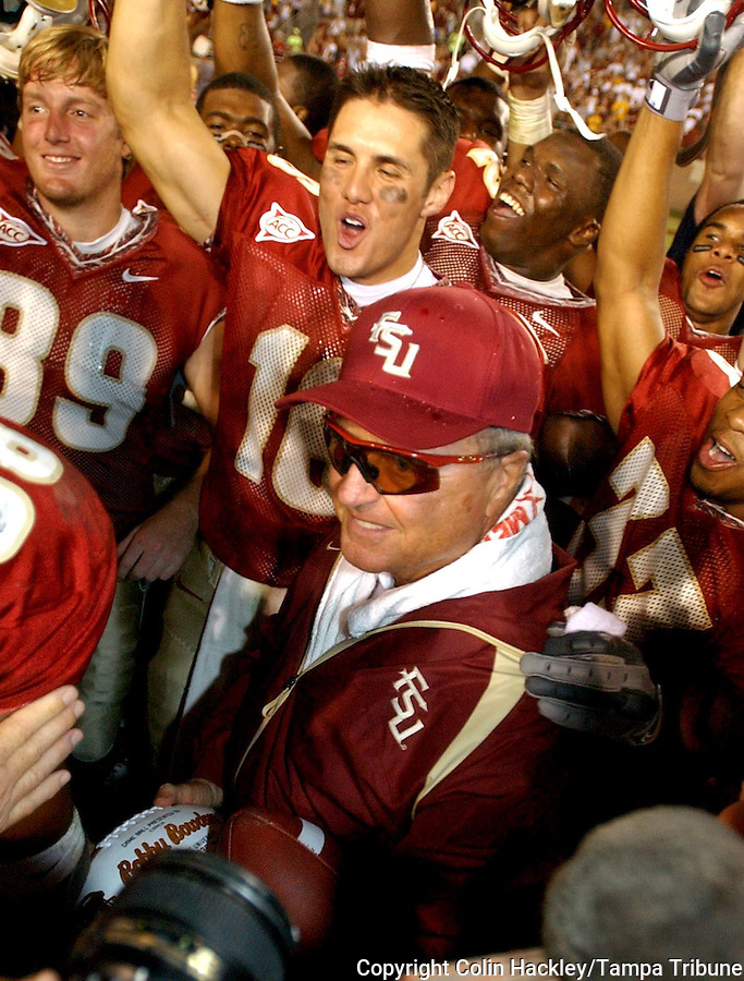 TALLAHASSEE, FL. 10/25/03-FSU Coach Bobby Bowden is surrounded by his players including Brian Sawyer, left, and Chris Rix after he won his 339th career game making him the winningest active Division 1A Coach after the Seminoles beat Wake Forest 48-24  Saturday at Doak Campbell Stadium in Tallahassee. COLIN HACKLEY PHOTO