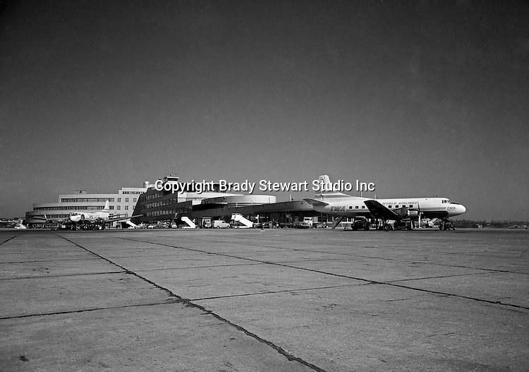 Pittsburgh PA:  TWA DC-3 Skyliner airplanes loading passengers at the Greater Pittsburgh airport - 1954