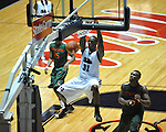 "Ole Miss' Murphy Holloway (31) dunks vs. Miami at the C.M. ""Tad"" Smith Coliseum in Oxford, Miss. on Friday, November 25, 2011. Ole Miss won 64-61 in overtime."