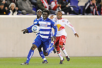 Ugo Ihemelu (3) of FC Dallas is chased by Dane Richards (19) of the New York Red Bulls. The New York Red Bulls defeated FC Dallas 2-1 during a Major League Soccer (MLS) match at Red Bull Arena in Harrison, NJ, on April 17, 2010.