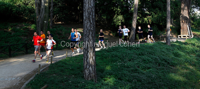 Firemen jogging around the bottom of the Labyrinthe (Labyrinth) located in the Jardin des Plantes, Paris, 5th arrondissement, France. Founded in 1626 by Guy de La Brosse, Louis XIII's physician, the Jardin des Plantes, originally known as the Jardin du Roi, opened to the public in 1640. It became the Museum National d'Histoire Naturelle in 1793 during the French Revolution. Picture by Manuel Cohen