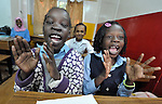 Refugee girls in class in a school operated by St. Andrew's Refugee Services in Cairo, Egypt. The school is supported by Church World Service.