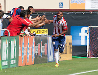 Santa Clara, California - Sunday May 13th, 2012: Jose Erick Correa of Chivas USA celebrating with his coaches after his goal during a Major League Soccer match against San Jose Earthquakes at Buck Shaw Stadium