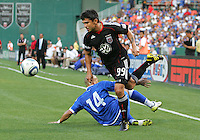 Jaime Moreno #99 of D.C. United breraks past Dennis Alas #14 of El Salvador during an international charity match at RFK Stadium, on June 19 2010 in Washington DC. D.C. United won 1-0.