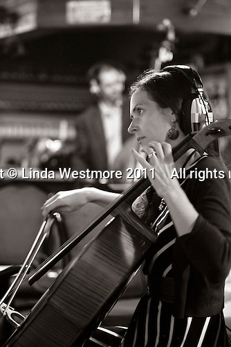 "Melanie Row, cellist with the ""Edge of Chaos Orchestra"" recording at the Blue Coconut Club, Pulborough, West Sussex."