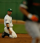 03 Jun 2006 Lincoln, NE Manhattan University's Ryan Marcoux coudln't  handle a throw at second base and watches as University of Miami's Tommy Giles would advance to third base during the NCAA Baseball Regionals at Haymarket Park in Lincoln, Ne Saturday night.(Chris Machian/Prairie Pixel Group)