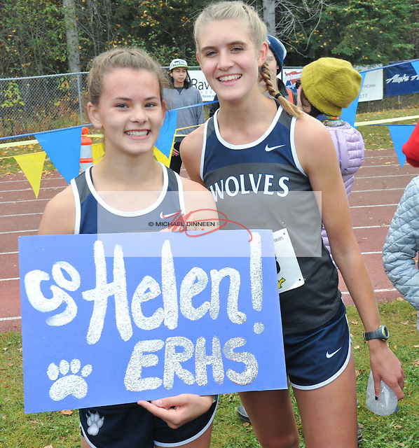 From left, Eagle River's Helen Wilson who ran a personal best 19:56 and Peyton Young (20:43) following the Alaska State Cross-Country Championshps Saturday, Oct. 1, 2016.  Photo for the Star by  Michael Dinneen