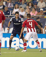 New England Revolution forward Milton Caraglio (9) considers his options. In a Major League Soccer (MLS) match, Chivas USA defeated the New England Revolution, 3-2, at Gillette Stadium on August 6, 2011.