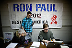 Volunteer Robert Terhune, right, signs up volunteers at Ron Paul's presidential campaign headquarters in Reno, Nev., January 31, 2012.