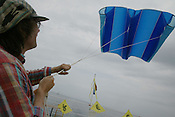 LUTZ TRECZOCKS AND HIS  KITE, JAPAN. 030702. .PIC &copy; JEREMY SUTTON-HIBBERT/GREENPEACE 2002..*****ALL RIGHTS RESERVED. RIGHTS FOR ONWARD TRANSMISSION OF ANY IMAGE OR FILE IS NOT GRANTED OR IMPLIED. CHANGING COPYRIGHT INFORMATION IS ILLEGAL AS SPECIFIED IN THE COPYRIGHT, DESIGN AND PATENTS ACT 1988. THE ARTIST HAS ASSERTED HIS MORAL RIGHTS. *******
