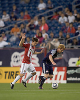 New England Revolution midfielder Pat Phelan (28) controls the ball as Chivas USA midfielder Ben Zemanski (21) defends. Chivas USA defeated the New England Revolution, 4-0, at Gillette Stadium on May 5, 2010.