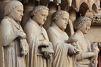 Statues of 3 saints and an angel with thurible (right), on the South portal or St Honore portal on the South transept of the Basilique Cathedrale Notre-Dame d'Amiens or Cathedral Basilica of Our Lady of Amiens, built 1220-70 in Gothic style, Amiens, Picardy, France. St Honore or Honoratus was the 7th bishop of Amiens who lived in the 6th century AD. Amiens Cathedral was listed as a UNESCO World Heritage Site in 1981. Picture by Manuel Cohen