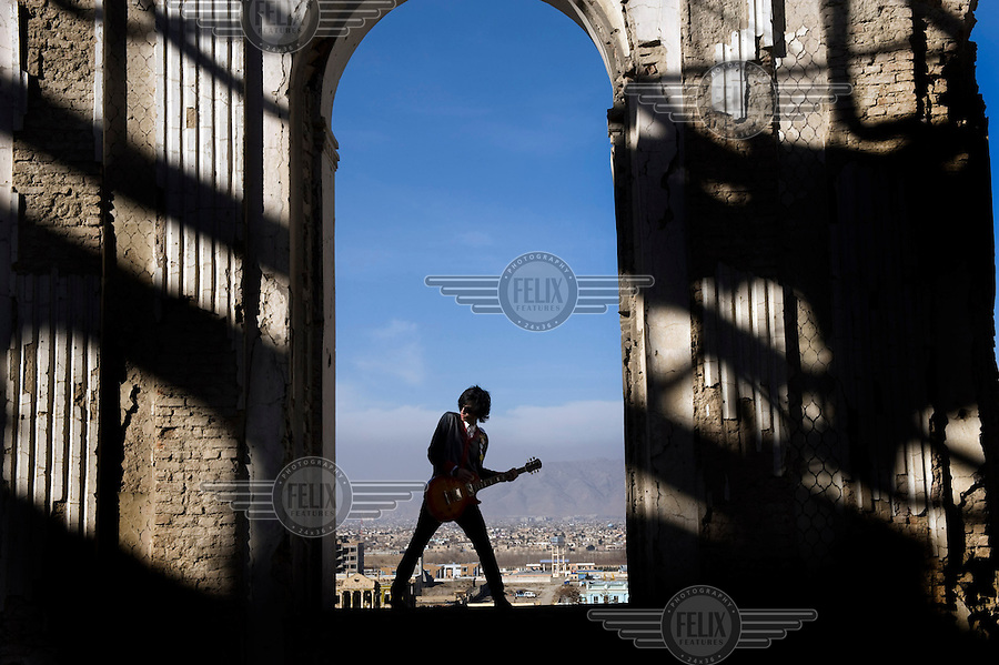 Sulyman Qardash, singer/guitarist in rock band Kabul Dreams plays his instrument in the ruins of a castle in Kabul. Kabul Dreams is also made up of bass player Siddique Ahmad and drummer Mujtaba Habibi, and they claim to be the country's first and only rock and roll group.