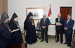 Palestinian President Mahmoud Abbas (Abu Mazen) meets with Armenian Patriarch in Jerusalem and Jordan the Patriarch Norhan Mnoggion in the West Bank city of Ramallah, on Feb. 28, 2013. Photo by Thaer Ganaim