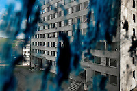 The Gipsy ghetto of Chanov seen through a dirty window in a devastated empty apartment block on outskirts of Most, Czech Republic, 26 March 2008.