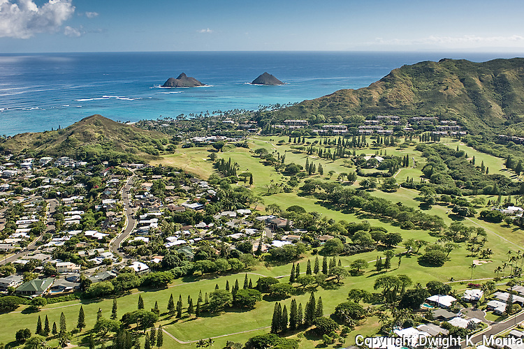 Aerial view of the Mid-Pacific Country Club golf course. The third and seventh fairways are in the foreground. The Mokulua Islands and the Bluestone condominiums are in the distance.
