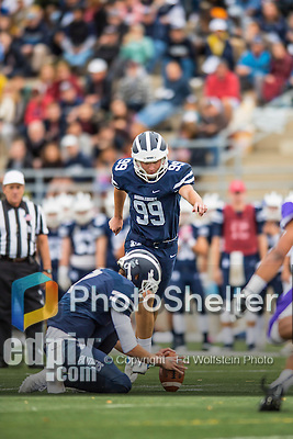8 October 2016: Middlebury College Panther Kicker Carter Massengill, a Freshman from Summit, NJ, approaches holder Jared Lebowitz, for points against the Amherst College Purple & White at Alumni Stadium in Middlebury, Vermont. The Panthers edged out the Purple & While 27-26. Mandatory Credit: Ed Wolfstein Photo *** RAW (NEF) Image File Available ***