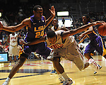 "Mississippi's Jarvis Summers (32) drives against LSU's Storm Warren (24) in NCAA college basketball at the C.M. ""Tad"" Smith Coliseum in Oxford, Miss. on Saturday, February 25, 2012. (AP Photo/Oxford Eagle, Bruce Newman)..."