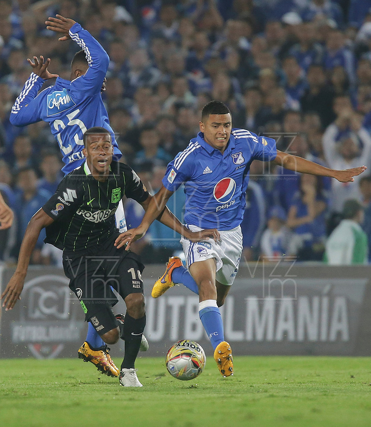 BOGOTA - COLOMBIA -31 - 03 - 2016: Carlos Henao (Der.) jugador de Millonarios disputa el balón con Jonathan Copete (Izq.) jugador de Atletico Nacional, durante partido aplazado de la fecha 9 entre Millonarios Atletico Nacional, de la Liga Aguila I-2016, jugado en el estadio Nemesio Camacho El Campin de la ciudad de Bogota.   / Carlos Henao (R) player of Millonarios vies for the ball with Jonathan Copete (l) player of Atletico Nacional, during a postponed match between Millonarios and Atletico Nacional,  for the date 9 of the Liga Aguila I-2016 at the Nemesio Camacho El Campin Stadium in Bogota city, Photo: VizzorImage / Ivan Valencia / Cont.