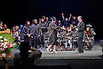 A students receives her diploma  as classmates celebrate with her during graduation for Alta Vista High School May 30.<br />