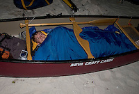A backcountry camper prepares to sleep in his canoe on Round Key in the Everglades of South Florida.