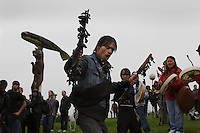 Dancing and singing followed a totem raising ceremony in heavy rain storms where seven poles are added to the Tlinget park.  People carried one pole through town where it was carved and all helped pull on ropes to raise it into place. Tlingit, Haida and Shimshane people came together for the historic event.