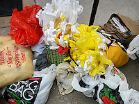A selection of plastic bags, recycled for use in packaging shoppers' purchases in a flea market in New York on Saturday, September 24, 2016. (© Richard B. Levine)