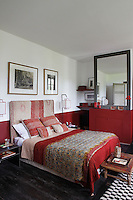 The red bedroom has been furnished with textiles from all over the world including Turkey and West Bengal as well as with local fabrics and Paris flea-market finds