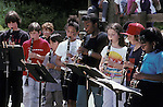 Berkeley CA 5th grade kids (Preteens) performing music at school fair, showing a variety of heights