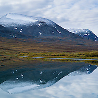 Autumn mountain reflection in river, Alisvagge from near Alesjaure mountain hut, Kungsleden trail, Lappland, Sweden