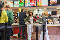 Customers on line at a busy Wendy's fast food restaurant in New York on Wednesday, May 6, 2015. Wendy's announced that it will sell 640 company owned stores to franchisees. The sales, which McDonald's is doing also, generates cash and reduces expenses for the company. (© Richard B. Levine)