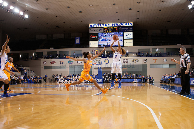 Kentucky point guard Jennifer O'Neill (0) shoots a wide open 3 point shot while Tennessee center Isabelle Harrison (20) dives to guard during the first half of the Kentucky Hoops versus Tennessee Vols at Memorial Coliseum in Lexington, Ky., on Thursday, January 29, 2015. Photo by Caleb Gregg | Staff