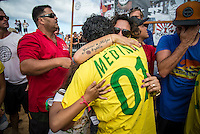 Pipeline, North Shore of Oahu, Hawaii Friday December 19 2014) Charlie Medina (BRA), Simone Medina (BRA) and daughter Sophia Medina (BRA) embrace after Gabriel has won the World Title.. - The final stop of the 2014  World Championship Tour, the Billabong Pipe Masters in Memory of Andy Irons, was  ccompleted today in NW double overhead surf. <br /> Gabriel Medina (BRA) became the first ever Brazilian World Champion after both rival contenders , Kelly Slater (USA) and Mick Fanning (AUS) were eliminated from the contest. Medina went onto finish 2nd overall behind Julian Wilson (AUS). <br /> In the overlapping heat format Wilson surf three consequent heats and still had enough entry to take out the 30 minute final.<br /> By winning the final Wilson also won the covered Vans Triple Crown of Surfing for best overall performance through the whole Triple Crown.<br /> <br /> The Billabong Pipe Masters in Memory of Andy Irons will determine this year&rsquo;s world surfing champion as well as those who qualify for the elite tour in 2015. As the third and final stop on the Vans Triple Crown of Surfing Series  the event will also determine the winner of the revered three-event leg.<br /> <br />  Photo: joliphotos.com