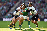 Simon Zebo of Ireland takes on the Romania defence. Rugby World Cup Pool D match between Ireland and Romania on September 27, 2015 at Wembley Stadium in London, England. Photo by: Patrick Khachfe / Onside Images