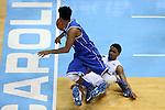 07 March 2015: Duke's Quinn Cook (dark blue) gets tied up with North Carolina's Joel Berry II (below). The University of North Carolina Tar Heels played the Duke University Blue Devils in an NCAA Division I Men's basketball game at the Dean E. Smith Center in Chapel Hill, North Carolina. Duke won the game 84-77.