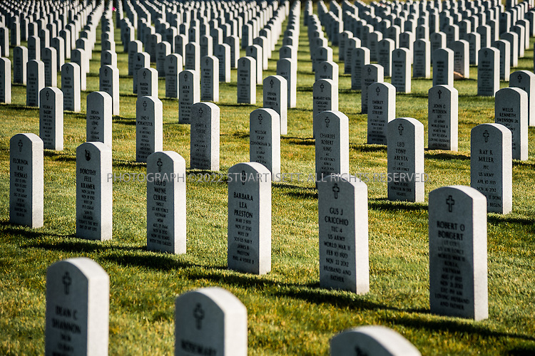 9/30/2016-- Tahoma National Cemetery, Kent, WA, USA<br /> <br /> Here: Gravestones of veterans and their spouses at the Tahoma National Cemetery.<br /> <br /> James Lindley, 34, an undertaker and US Marine Corp Veteran, works at the Columbia Funeral Home in Seattle, Washington and has taken it upon himself to process the remains of indigent veterans and ensure their remains are placed in Tahoma National Cemetery in nearby Kent, WASH. The veterans are given full military funerals with active service members as well as volunteers who stand-in for unavailable next-of-kin, accepting the folded flags provided by the Veterans Administration.<br /> <br /> On this day, with the help of Mr. Lindley, the remains of 4 veterans were interred at the Tahoma National Cemetery: <br /> <br /> Richard Fesler, born 1951, died 2014. US Army Veteran<br /> Rocky Stallone, born 1951, died 2014. Marine Corps veteran<br /> Russell Ristow, born 1944, died 2014. US Army veteran.<br /> Wayne Roberts, Born 1937, died 2014. US Navy veteran.<br /> <br /> <br /> Credit: Stuart Isett for The Wall Street Journal. <br /> VETBODIES<br /> <br /> &copy;2016 Stuart Isett. All rights reserved.