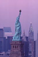 Statue of Liberty and Midtown Manhattan, New York City, New York, USA