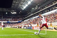 Thierry Henry (14) of the New York Red Bulls takes a corner kick. The New York Red Bulls and the Philadelphia Union played to a 0-0 tie during a Major League Soccer (MLS) match at Red Bull Arena in Harrison, NJ, on August 17, 2013.