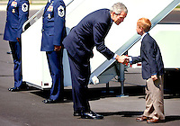 09/21/06--TAMPA--President Bush shakes hands with Zachary Bonner, 8, founder of Little Red Wagon Foundation Inc., a non-profit that helps kids in distress, shortly after Air Force One landed in Tampa, Thursday. Bonner received the President's Volunteer Service Award for the work he has done in helping others. Photo by Julie Busch Branaman