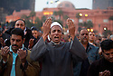 """An Egyptian Imam leads protesters in evening prayer during a """"million man march"""" demonstration February 01, 2011 in Central Cairo's Tahrir, or """"Liberation"""" square. The march capped a week of protests that are threatening to bring down the nearly 30 year old regime of Hosni Mubarak."""