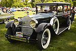Old Westbury, New York, U.S. - June 1, 2014 -  A black 1928 Packard 443 Limousine, owner MARIO IASPARO of CENTEREACH, is an entry at the Antique and Collectible Auto Show held on the historic grounds of elegant Old Westbury Gardens in Long Island, and sponsored by Greater New York Region AACA Antique Automobile Club of America.