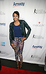 E! News Correspondents Alicia Quarles Attends The 2013 Skating with the Stars honoring B Michael and Andrea Joyce -A benefit gala for Figure Skating in Harlem Held At Trump Rink, Central Park, NY