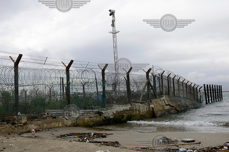 Thick wire forms a border fence between Gibraltar and Spain.