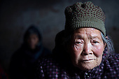Old people living in a Chinese village in Henan province survive on meagre savings. Many say they would like to be placed in modern housing blocks that the government is providing in exchange for knocking down farmland. <br /> <br /> China is pushing ahead with a dramatic, history-making plan to move 100 million rural residents into towns and cities over the next six years &mdash; but without a clear idea of how to pay for the gargantuan undertaking or whether the farmers involved want to move.<br />