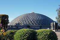 The Bloedel Floral Conservatory and Henry Moore sculpture entiitled Knife Edge-Two Piece in Queen Elizabeth Park, Vancouver, British Columbia, Canada