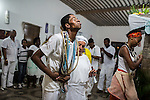 RIO DE JANEIRO, BRAZIL - JANUARY 24: Cassiano Linhares is overcome with an orixa during a candomble ceremony, in Rio de Janeiro, Brazil, on Saturday, Jan. 23, 2015. Brazil's Afro-Brazilian religions which in recent years have come under increasing threats and prejudice, particularly from the growing number of evangelical churches. Candombl&eacute; originated in Salvador, Bahia at the beginning of the 19th century when enslaved Africans brought their beliefs with them. Umbanda and candombl&eacute; are Afro-Brazilian religions practiced in mostly Brazil. <br /> (Lianne Milton for the Washington Post)