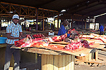Africa, Namibia, Windhoek. Preparing kapana, red meat for grilling, in the open market of Katutura in Windhoek.