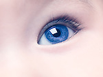Closeup of a blue eye of a six month old baby boy