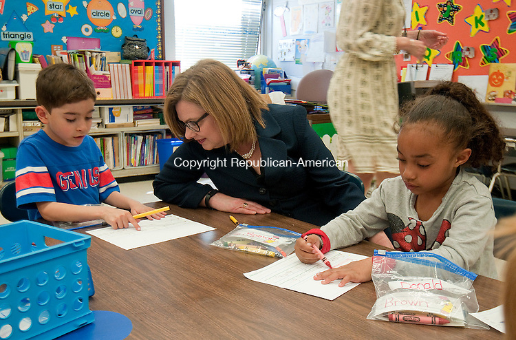 NAUGATUCK, CT--050715JS12-  Dr. Dianna R. Wentzell, Commissioner of the State Department of Education, talks with kindergarten students Brian Fanning, left, and Raelah Harris, right, as they work on their assignment &quot;Where I would like to go on an adventure&quot; during her visit to the Andrew Avenue School in Naugatuck on Thursday. Dr. Wentzell also met with school officials, teachers and local officials. <br /> Jim Shannon Republican-American