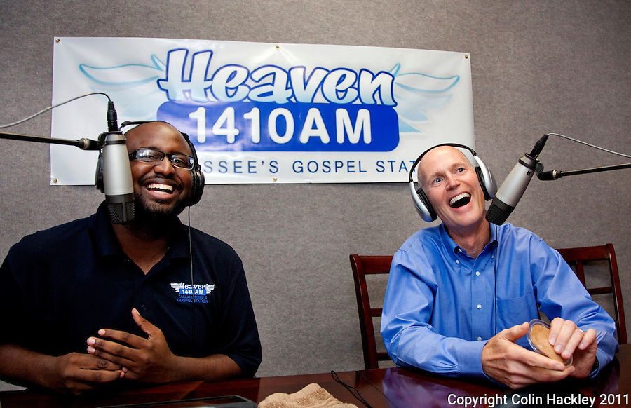 TALLAHASSEE, FLA. 7/28/11-SCOTTRADIO HACKLEY07-Gov. Rick Scott, right, shares a laugh with radio talk show host Jay Green during Green's show on gospel radio station WHBT 1410 AM, Thursday in Tallahassee. Recently Scott has been appearing on talk radio across the state several times a day as a way to get his message out to Floridians..COLIN HACKLEY PHOTO